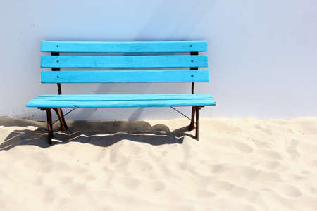 wooden bench: Blue wooden bench at a white sandy beach