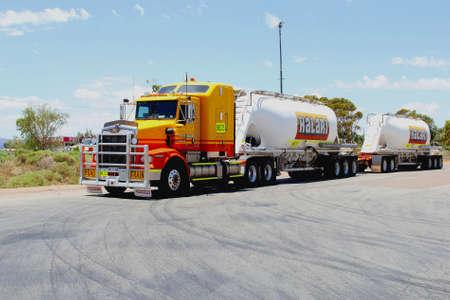 goods train: Stuart Highway, Australia, November 2015 Commercial Road train transports goods in the Australian Outback