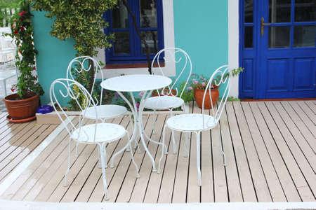 garden patio: Garden patio and garden furniture in vintage style, Greece Stock Photo