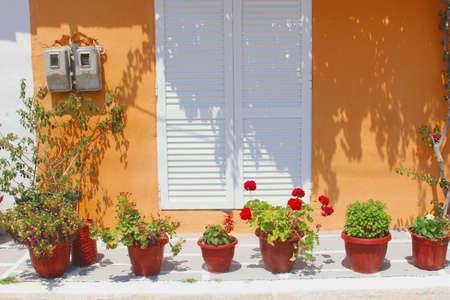 garden patio: Garden patio with flower pots, orange walls in Chalkidiki, Greece