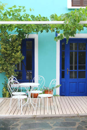 summer holidays: Garden patio furniture white, turquoise and blue wall by