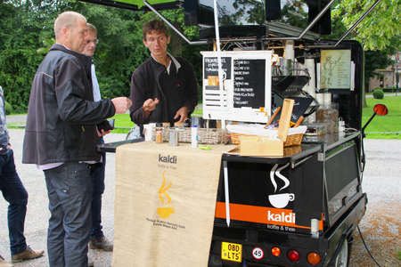 ambulant: Breukelen, Netherlands, July 2016 Man sells coffee in an ambulatory coffee stand on wheels Editorial