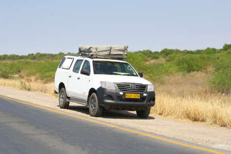 Keetmanshoop, October 2016 Toyota Hilux with a roof tent is parked along the B1 highway