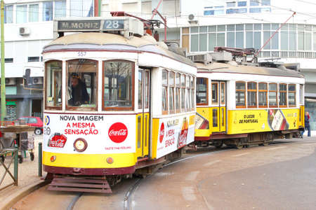 Lisbon, Portugal, January 2017 Two vintage wooden trams number 28 near Bairro Alto at the tramway