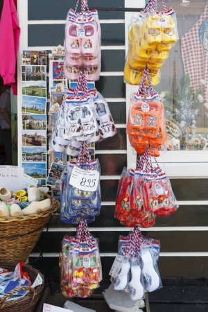 Typically Dutch slippers in the shape of wooden shoes are offered for sale in Marken in the Netherlands.