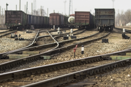 railway points: Railway junction  Perspective of crossing rails, traffic lights and train  Stock Photo