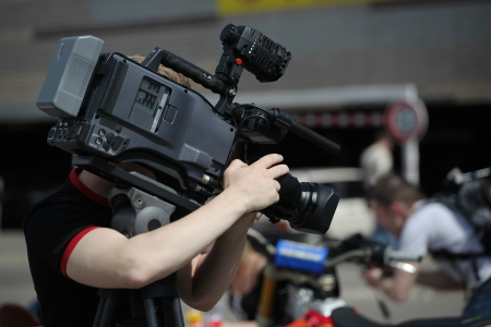 footage: Video camera operator working with his professional equipment