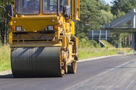 roller compactor:  Construction and repair of highway Stock Photo