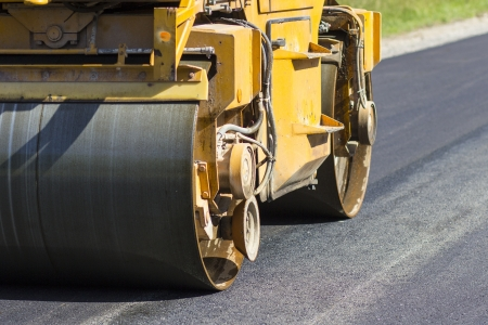 bagger:  Construction and repair of highway Stock Photo
