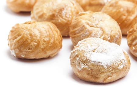 puffs: Cream puffs on white background Stock Photo