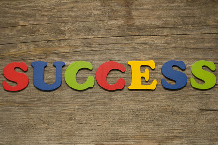 key words art: text success on a wooden background Stock Photo