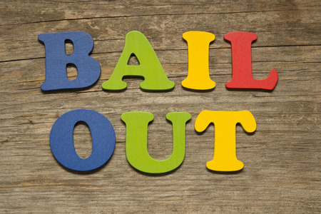 bail: Bail out text on a wooden background