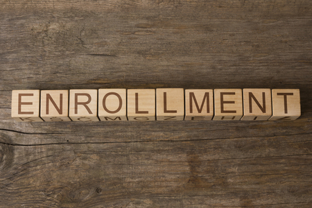 registry: ENROLLMENT word on wooden cubes Stock Photo
