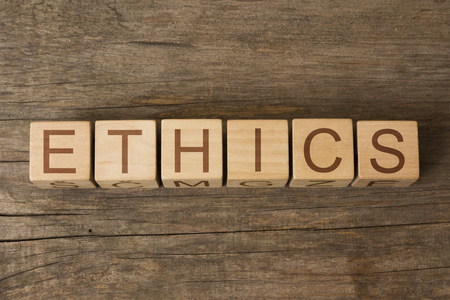 conduct: ETHICS word on wooden cubes