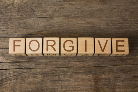 compassionate: FORGIVE word on wooden cubes