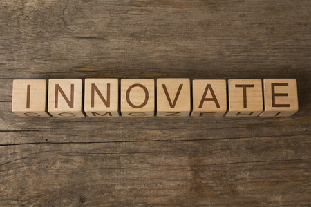 innovate: innovate word written on wooden cubes