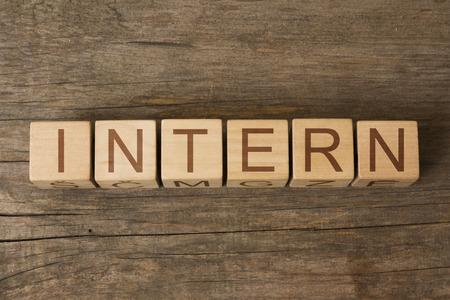 intern: INTERN word on wooden blocks