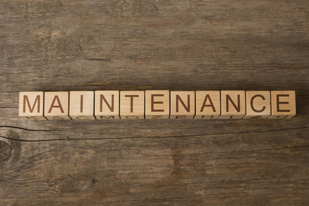 assertion: MAINTENANCE word on wooden cubes Stock Photo