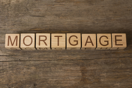 downpayment: MORTGAGE word on a wooden cubes