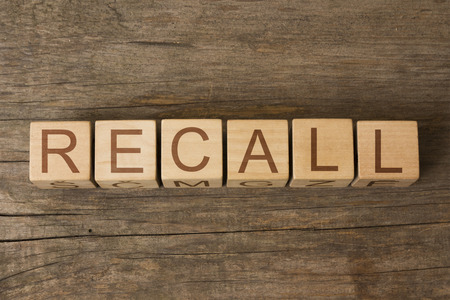 recall: RECALL word on wooden cubes Stock Photo