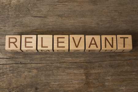 irrelevant: relevant word written on wooden cubes