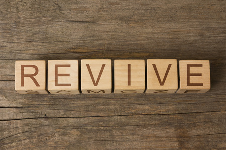 relaunch: the word of REVIVE on wooden cubes Stock Photo