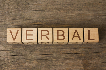 pronounce: the word of VERBAL on a wooden cubes