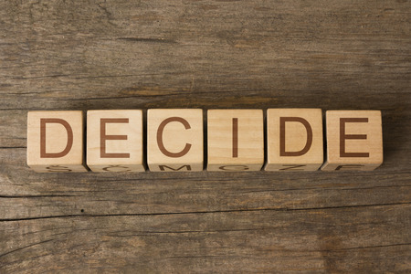 adjudicate: DECIDE word on wooden cubes Stock Photo