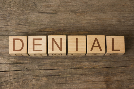 denial: the word of DENIAL on wooden cubes