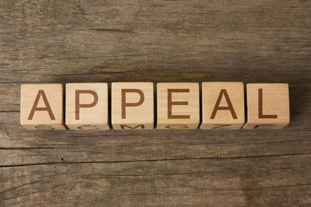 APPEAL word on wooden blocks