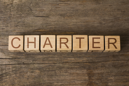 charter: the word of CHARTER on wooden cubes