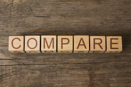 self worth: the word of COMPARE on a wooden cubes Stock Photo