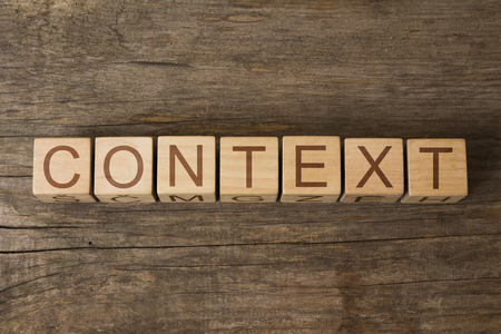 the word of CONTEXT on wooden cubes Stock Photo