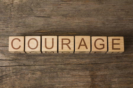the word of COURAGE on wooden cubes