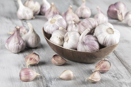 Close-up garlic bulbs and garlic cloves on wooden background. Garlic. Fresh garlic Stock Photo