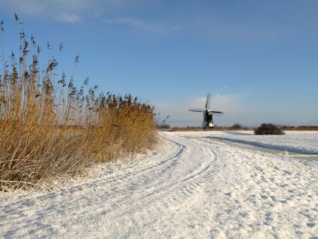Traditional windmill in winter setting, the netherlands Stock Photo - 6356945