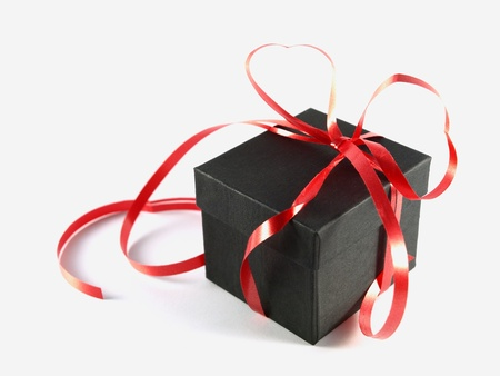 Black gift box with red bow   photo