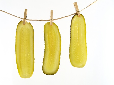 cucumber slice: Pickle slices hang out to dry isolated on white background