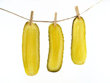 pickled: Gherkin slices hang out to dry isolated on white background
