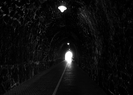 silhouette of a couple walking down a tunnel  photo