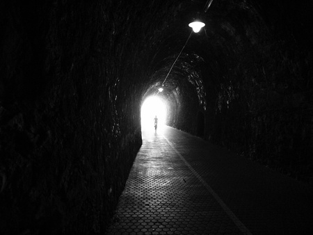 scary man: Human silhouette in tunnel, Light at End of Tunnel  Stock Photo