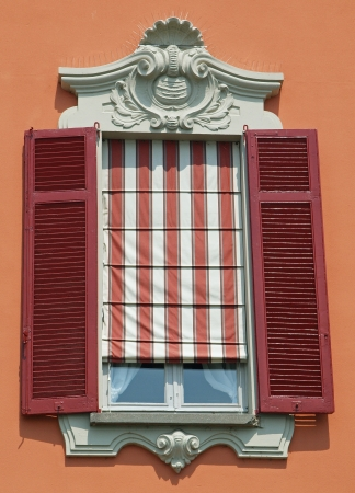ornamented: Ornamented italian window with shutters Stock Photo