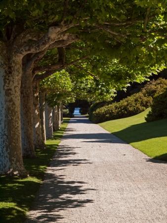 bellagio: Path in garden along the shore of lake Como, Italy  Stock Photo