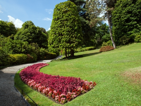 flowered: Curved pebble path in flowered park  Stock Photo