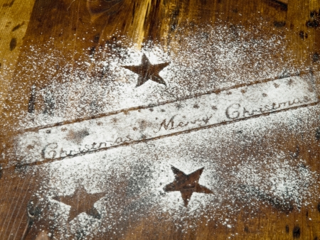 powdered sugar: Christmas decoration with powdered sugar on a wooden background  Stock Photo