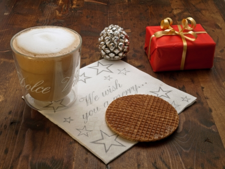 Christmas coffee break with stroopwafel and christmas gift photo