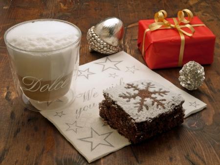 Christmas coffee break with chocolate brownie and christmas gift photo