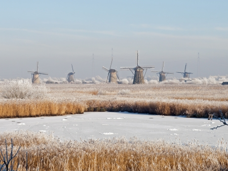 Winter landscape with windmills in Kinderdijk, Netherlands  photo