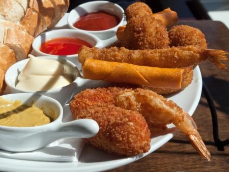 Fingerfood op een bord Stockfoto