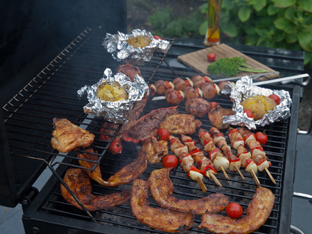 Grilled food on braai photo